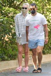 Sophie Turner Hides Her Growing Bump in an Oversized Button Up Shirt