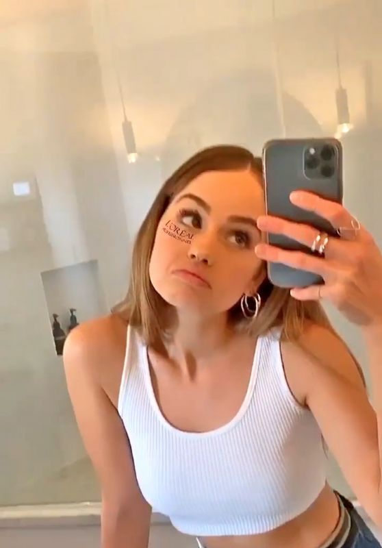 Debby Ryan in Tank Top in Front of the Mirror, May 2020