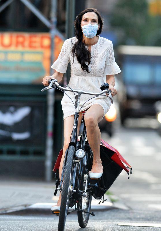 Famke Janssen - Rides Bike in New York 07/14/2020