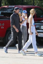 Abby Champion in a Light Grey Joggers, White Yeezy Sneakers and a Blue and White Nike Tank With Patrick Schwarzenegger 08/04/2020