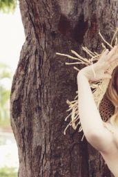 Emma Stone - Photoshoot for Vanity Fair August 2011
