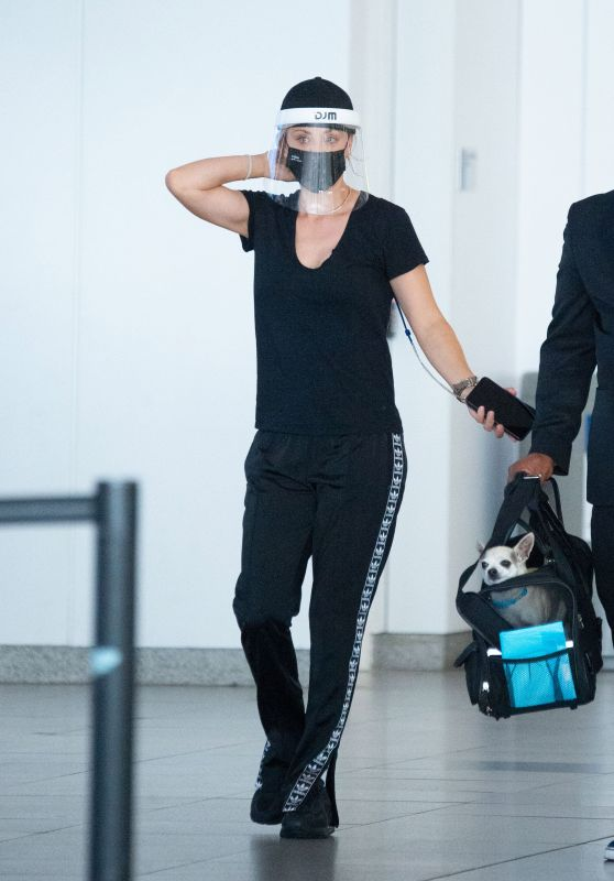 Kaley Cuoco in Travel Outfit - JFK Airport in NYC 08/10/2020