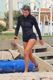 Sofia Richie in Black Wetsuit in Malibu 08/21/2020