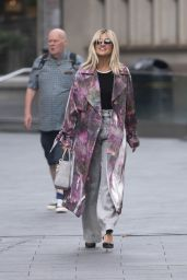 Ashley Roberts in a Purple and Pink Coat and Grey Trousers 09/23/2020