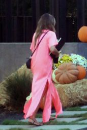 Chrissy Teigen in a Pink Satin Dress - Pumpkin Farm 10/25/2020