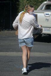 Dakota Fanning in White Blouse and Blue Jean Cutoffs - Los Angeles 10/13/2020