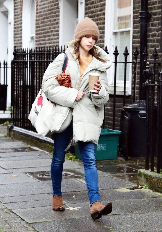 Emilia Clarke in an Oversized Puffer Jacket and Beanie Hat - London 10/25/2020