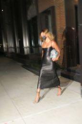 Hailey Bieber in a Skintight Black Dress and zebra Bottega Veneta Bag - Arriving for SNL in NY 10/17/2020