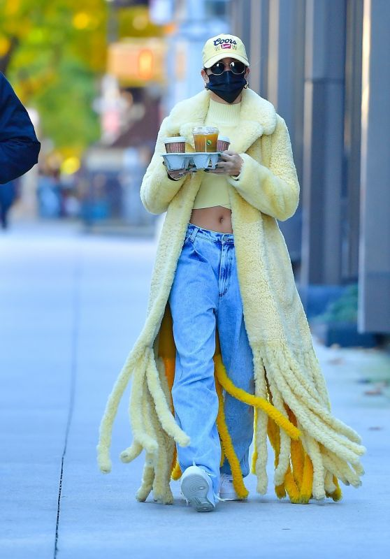 Hailey Bieber in a Thick, Fuzzy Yellow Coat and Pair of Baggy Acid Wash Jeans - NYC 10/17/2020