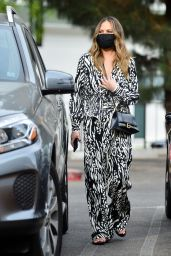 Chrissy Teigen in a Patterned Blouse and Pants - Los Angeles 11/05/2020