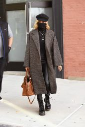 Diane Kruger in a Brown Glen Tartan Overcoat, Skintight Leather Trousers and Sleek Boots