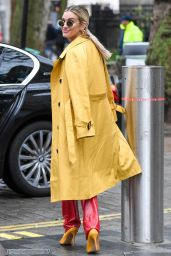 Ashley Roberts in a Yellow Trench Coat and Red PVC Trousers - London 12/09/2020