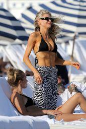 Charlotte McKinney in a Black Bikini on the Beach in Miami 12/20/2020