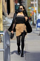 Famke Janssen in Tan Asymmetrical Skirt With Buttons and Lacy Top - NYC 12/13/2020