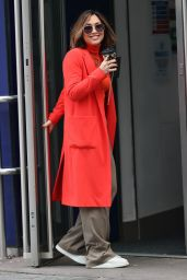 Myleene Klass in Bright Orange Tight Jumper and Khaki Slacks - London 12/31/2020