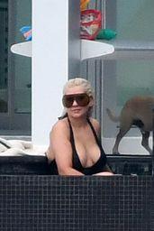 Christina Aguilera in a Black Swimsuit - Miami 02/12/2021