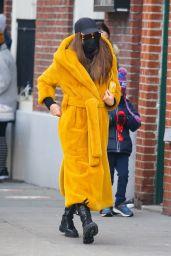 Irina Shayk in a Yellow Long Puffy Coat - New York 02/12/2021