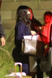 Kim Kardashian and Kylie Jenner - Returning From a Family Getaway to Turks and Caicos 01/29/2021