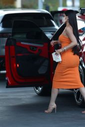 Kylie Jenner in an Orange Dress - Pumps Gas in Bel Air 02/22/2021