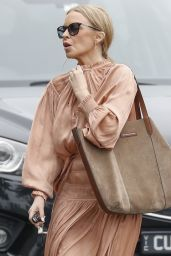 Kylie Minogue in a Flowing Peach Coloured Dress 02/12/2021