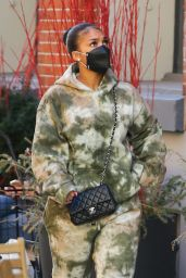 Lori Harvey Wears Chanel Bag and Prada Boots - NYC 02/16/2021