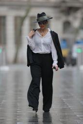 Myleene Klass Wearing a Top Hat and Monochrome Trouser Suit - London 02/03/2021