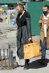 Chrissy Teigen in a Full-Length Black Leather Coat and Open-Toe High Heels - NY 03/07/2021