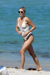 Claire Holt in a Swimsuit on the Beach in Miami 03/27/2021