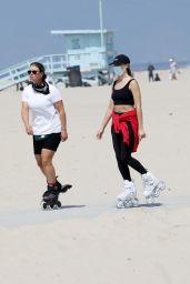 Margot Robbie - Rollerblading on the Beach in Malibu 04/18/2021