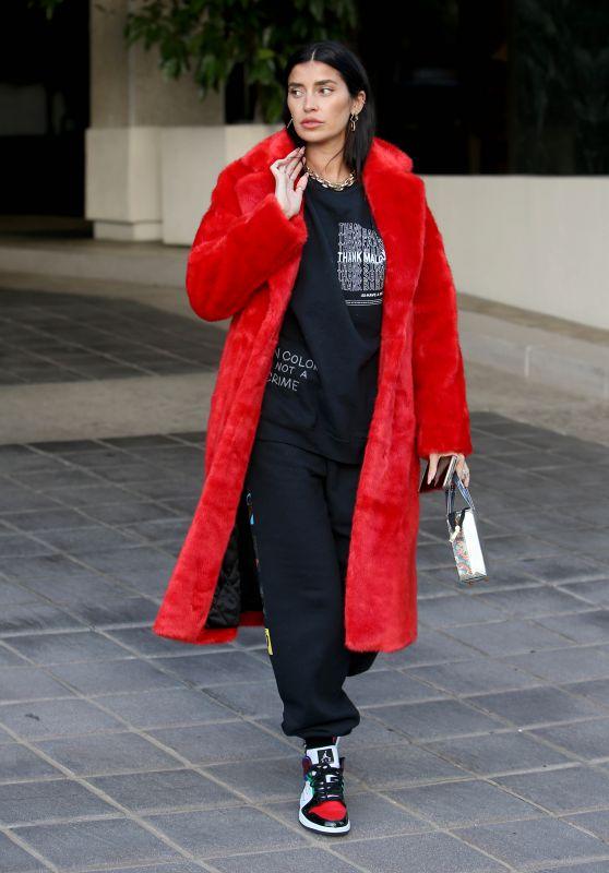 "Nicole Williams in an Oversized Phillip Plein Coat With ""I"
