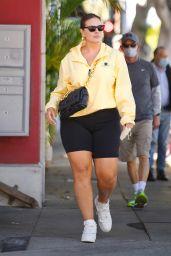 Ashley Graham in Bike Shorts and Yellow Windbreaker - Santa Monica 05/05/2021