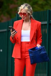Caprice Wears Red Trouser Suit - London 05/25/2021