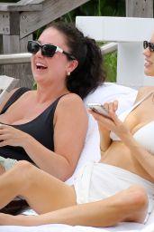 Charlotte McKinney in a White Bikini - Beach in Miami 05/14/2021