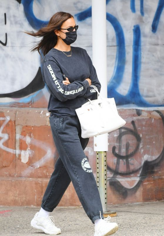 Irina Shayk Wears Gray Sweats, White Designer Sneakers and a Leather Tote - NYC 05/24/2021