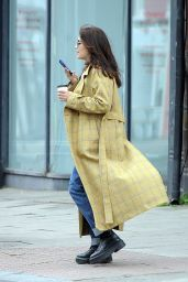 Jenna Coleman Wearing Blue Tinted Shades, Mustard Checkered Coat, Cream Top, Jeans and a Pair of Boots 05/17/2021