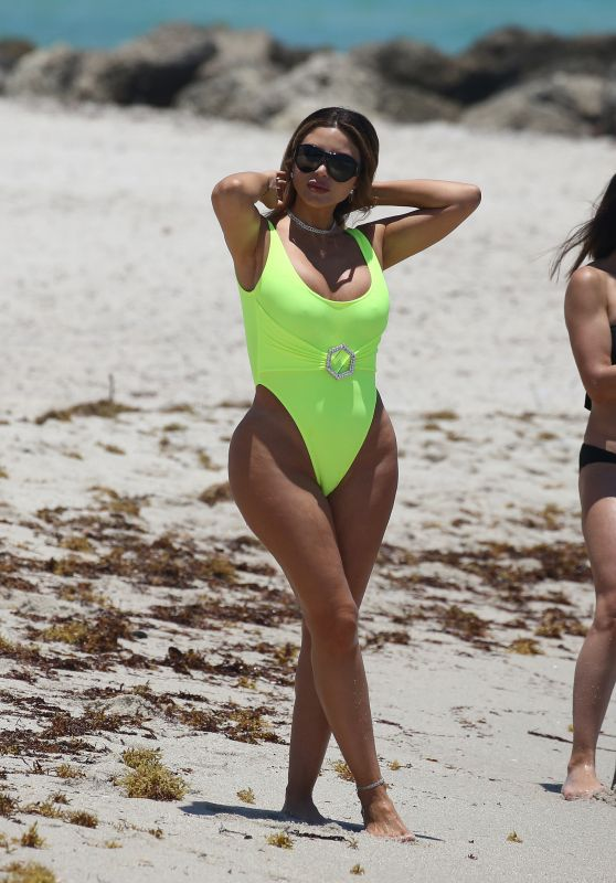 Larsa Pippen in a Neon Yellow Swimsuit at the Beach in Miami 05/28/2021