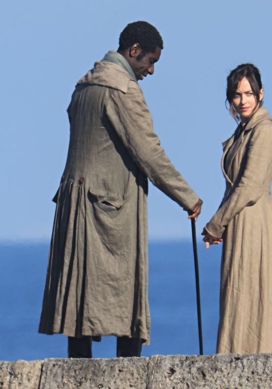 "Dakota Johnson - ""Persuasion"" Set on The Cobb at Lyme Regis 06/15/2021"