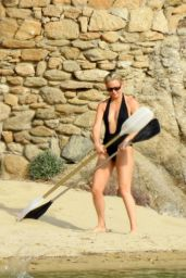 Kate Hudson in a Plunging Black Swimsuit on the Beach in Greece 06/13/2021