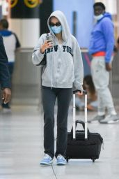 Lily Rose Depp in a Grey Hoodie and Sunglasses at JFK Airport in NY 06/17/2021