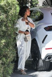 Lori Harvey in a White Jumpsuit at the Sunset Towers in West Hollywood 06/23/2021
