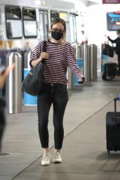 Olivia Wilde in Tight Jeans and Striped Shirt - Airport in LA 06/20/2021