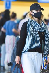 Olivia Wilde in Travel Outfit - JFK Airport in NYC 06/28/2021