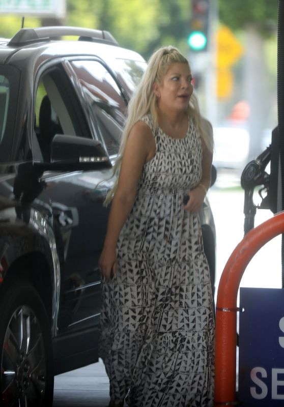 Tori Spelling - Fills Up Her Car With Gas in Beverly Hills 06/16/2021
