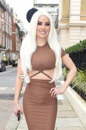 Carla Howe in a Brown Crop Top and Skirt 07/27/2021