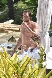 Lottie Tomlinson in a Bikini at the pool in Marbella 06/30/2021