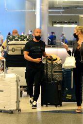 Chrishell Stause and Jason Oppenheim Return to LA 08/09/2021