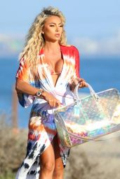 Khloe Terae in a Patterned Dress While Carrying an Oversized Louis Vuitton Bag - Beach in Santa Monica 08/23/2021