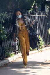 Nancy Xu in a Mustard Coloured Velvet Jumpsuit and Snakeskin Jacket - London 08/03/2021