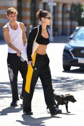 Bella Hadid Wearing a Black and Yellow Adidas Tracksuit and Custom Hoop Earrings - NYC 09/24/2021