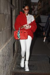 Winnie Harlow in All White With a Pop of Color Donning a Red Jacket - Milan Fashion Week 09/25/2021